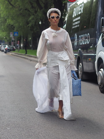 MILAN, Italy: 19 September 2019:: Fashion blogger street style outfit before Armani fashion show during Milan fashion week woman Fall  winter 20192020