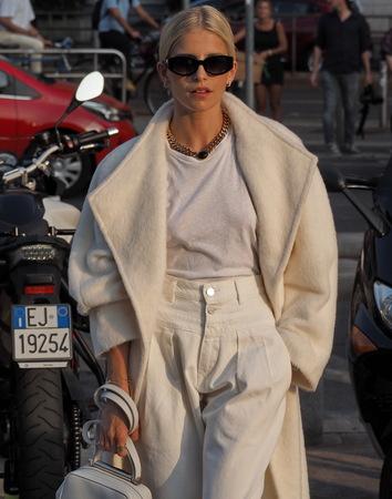 MILAN, Italy: 18 September 2019: Caroline Daur street style outfits before Alberta Ferretti fashion show during Milan fashion week Spring  Summer