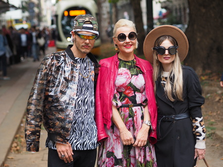 MILAN, Italy: 22 September 2019: Fashion bloggers street style outfits before Dolce & Gabbana fashion show during Milan fashion week Spring  Summer 20192020