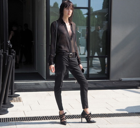 MILAN, ITALY - JUNE 16, 2018: Top model TEDDY QUINLIVAN posing for photographers after Neil Barrett fashion show, during Milan Fashion Week Men and women spring collections.