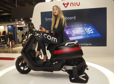 MILAN, ITALY - NOVEMBER 8: Model on scooter during EICMA, international motorcycle exhibition on NOVEMBER 8, 2018 Milan, Lombardy Editorial
