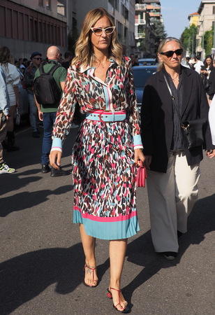 MILANO, Italy: September 20, 2019: Fashion bloggers posing in outfit style before ICEBERG fashion show during MFW spring  summer 20192020 Редакционное