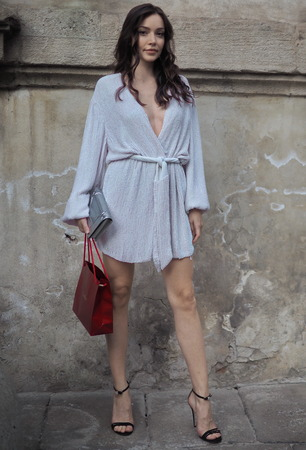 MILAN, Italy: 19 September 2019: Fashion blogger street style outfit before Bottega Veneta fashion show during Milan fashion week Spring  Summer 20192020