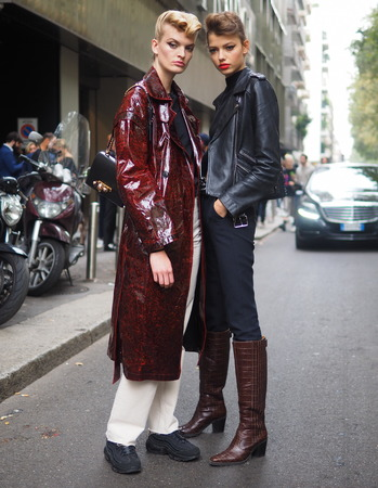 MILAN, Italy: 22 September 2019: Two models street style outfits after Dolce & Gabbana fashion show during Milan fashion week Spring  Summer 20192020