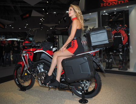 MILAN, ITALY - NOVEMBER 7, 2019: Model on motorbike at EICMA, international motorcycle exhibition, Lombardy, Italy.