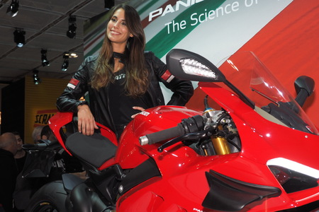 MILAN, ITALY - NOVEMBER 7, 2019: Model on motorbike hostess at EICMA, international motorcycle exhibition, Lombardy, Italy. Editorial
