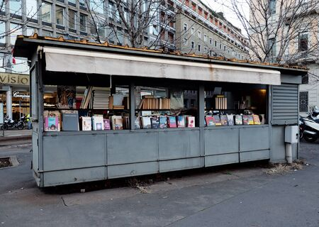 Milan, Italy: 23 December 2019: A vintage street library in Cavour square, Milan, Italy Publikacyjne