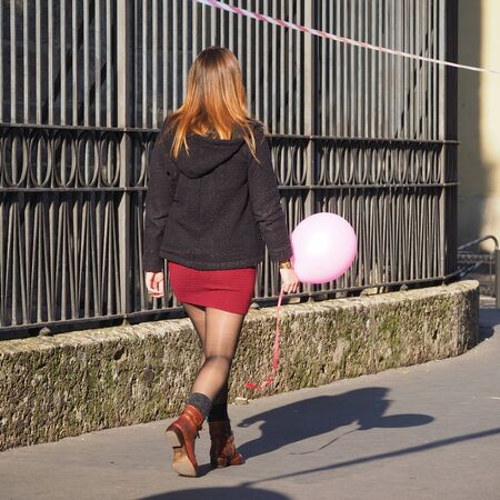 Sexy girl walking in minidress and black pantyhose