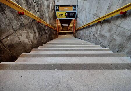 MILAN, ITALY - 23 December 2019: Entrance to Turati metro station in Milan. Turati is a station on the Line 3 of Milan Metro, yellow line.