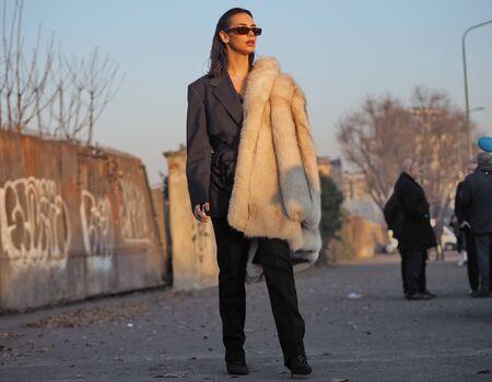 MILAN, Italy: 12 January 2020: Fashion Blogger street style outfit before Prada fashion show during Milan fashion week Spring / Summer