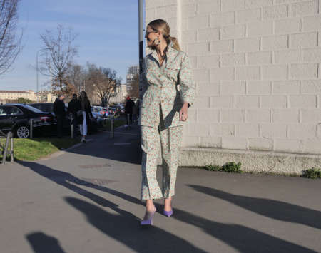 MILAN, Italy: 20 February 2020: Fashion blogger street style outfit before Prada fashion show during Milan fashion week woman Spring / Summer