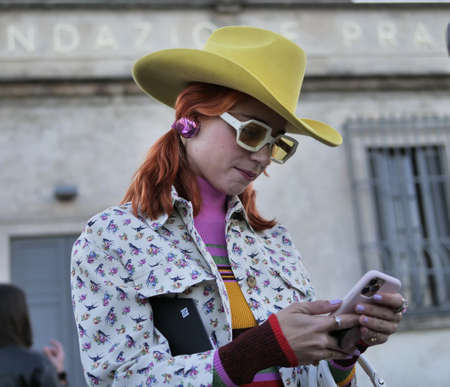 MILAN, Italy: 20 February 2020: Fashion Blogger street style outfit before and after Prada fashion show during Milan fashion week woman Spring / Summer