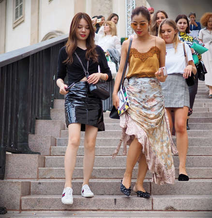 MILAN, Italy: September 21, 2018: Fashion bloggers and models in Duomo square after ACT 1 fashion show during MFW fall / winter 2018/2019.