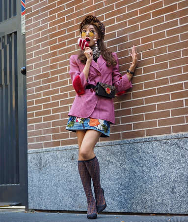 MILAN, Italy: September, 20 2018: Fashion blogger in street style outfit after FENDI fashion show during Milan fashion week fall / winter 2018/2019.