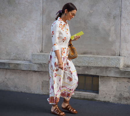MILAN, Italy- SEPTEMBER 20, 2018: Fashionable woman street style outfit before PRADA fashion show, during Milan Fashion Week fall winter 2018/2019.