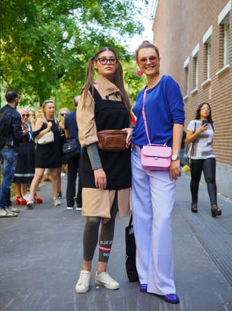 MILAN, Italy, 20 septembre 2018: Fashionable women posing for photographers in the street before FENDI fashion show during Milan fashion week fall winter 2019.