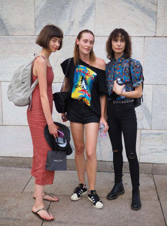 MILAN, Italy: September 21, 2018: Fashion bloggers in street style outfits after ACT 1 fashion show during MFW fall / winter 2018/2019.