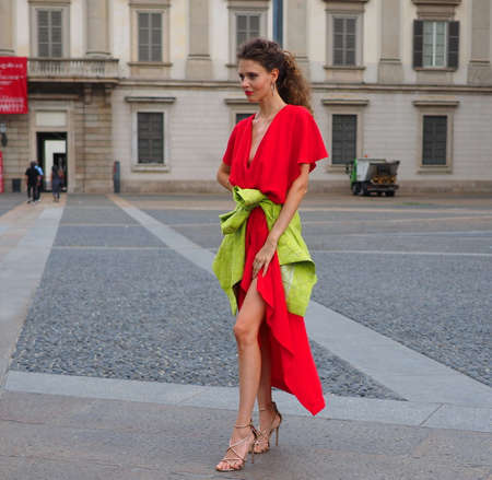 MILAN, Italy: September 21, 2018: Model posing for photographers in Duomo square after ACT 1 fashion show during MFW fall / winter 2018/2019.
