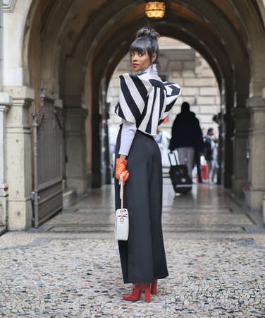 MILAN, Italy: 19 February 2020: Giedele de Assis street style outfit before CALCATERRA fashion show during Milano Fashion week 2020/2021