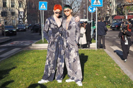 Milan, Italy, 11 January 2020: Men fashion bloggers street style outfits before Armani fashion show during Milano fashion week 2020