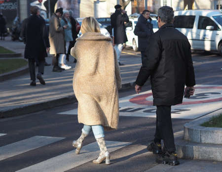 Milan, Italy, 11 January 2020: Fashionable couple street style outfit before Armani fashion show during Milano fashion week 2020 Editoriali