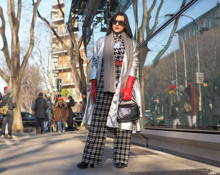 Milan, Italy, 11 January 2020: Fashion blogger street style outfit before Armani fashion show during Milano fashion week 2020