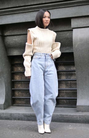 MILAN, Italy: 22 February 2020: Yoyo Cao street style outfit before Philosophy by Lorenzo Serafini fashion show during Milan fashion week Sprin