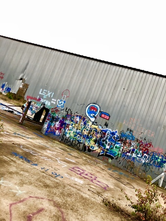 Old airplane hanger with graffiti spray paint art
