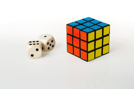 Two dice and a rubiks cube on white background