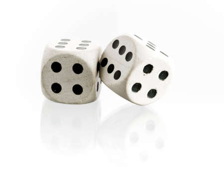 Two dice with reflection on a white background