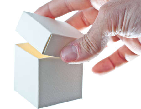 An hand opens a paper box Stock Photo