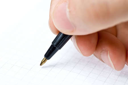 An hand who writes in a blank paper sheet Stock Photo - 13225416
