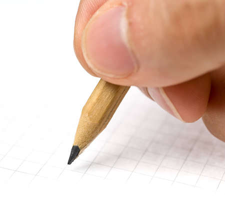 An hand who writes in a blank paper sheet
