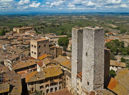 Twin towers in a medieval city  San Gimignano, Tuscany, Italy  Stock Photo