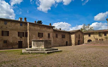Medieval city square in San Gimignano, Tuscany, Italy, Europe Stock Photo - 13735143