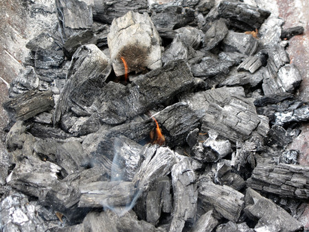 Smoking burning charcoal photo