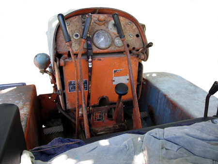 Dashboard old italian crawler tractor isolated on white background photo