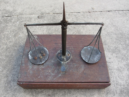 steelyard: Vintage handmade balance scale with hunting cartridge primers on the left plate Stock Photo