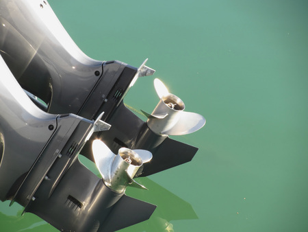 outboard: Two outboard boat motors tuned up and trying on the first run Stock Photo