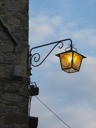 dodgy: Vintage street lamp in medieval village at twilight. Tuscany, Italy Stock Photo