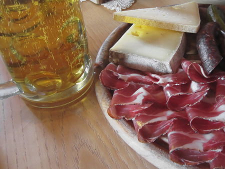 tyrolean: Typical South Tyrolean snack with speck, mountain cheese, smoked sausages and a cold mug of light beer