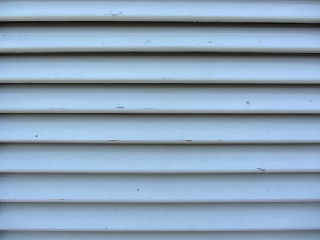 jalousie: Old jalousie window with wooden slats gray painted texture