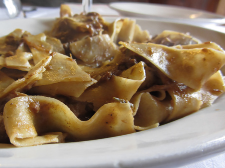 Pappardelle with boar ragu. Tuscan typical recipe of italian pasta