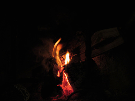 burning fireplace: Burning fireplace with fire flames on black background Stock Photo