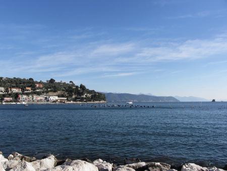 spezia: Landscape of Golfo Dei Poeti with its mussel farm in the sea. Province of La Spezia, Italy