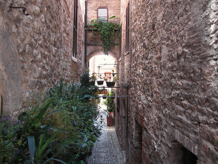 spello: Hidden alley in old village of Spello, Italy Stock Photo