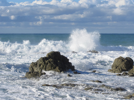 wavely: Stormy sea along Tuscany coastline in Livorno, Italy Stock Photo