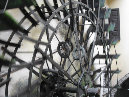 water wheel: The rotary motion of the water wheel in an old historic watermill in italian village . Borghetto fraction of Valeggio sul Mincio (province of Verona) , Italy