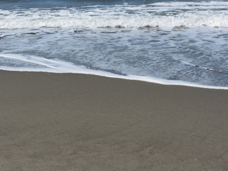forte: Wave of the sea on the sand beach. Forte dei marmi, Province of Lucca, Italy Stock Photo