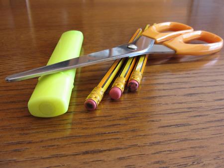 School office supplies on wooden table Stock Photo